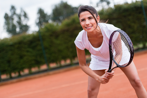http://www.dreamstime.com/stock-photos-woman-playing-tennis-court-holding-racket-image30893963