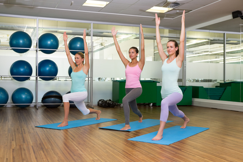 http://www.dreamstime.com/stock-images-yoga-class-warrior-pose-fitness-studio-leisure-center-image42563224